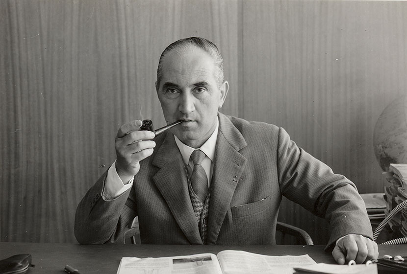 1960s. Pipe-smoking Franco at his desk in Transfield House.