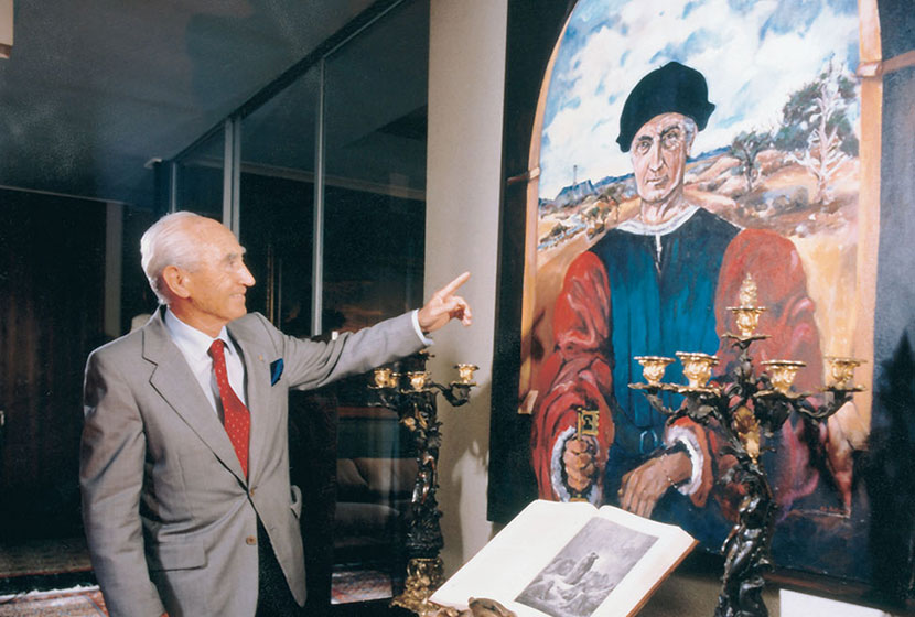 Franco in front of his portrait, in the garb of a Renaissance man, painted by Pio Carlone.