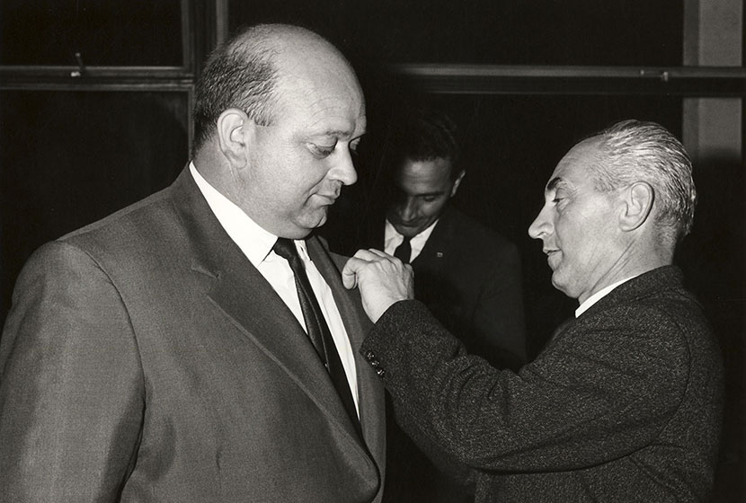 1966. Franco pins on Giancarlo Cecchini his 10-year long service badge.