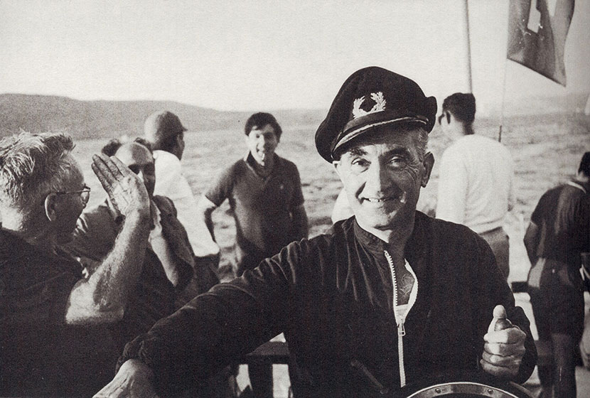 1960s. Franco at the helm of Transfield-built fast boat Trin