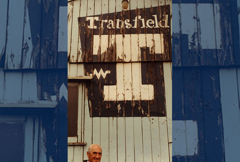Franco in front of the original, 1956 signage at the Port Kembla timber office.