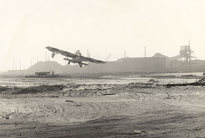 December 1975. An Airtruk taking off from a rough airstrip at Newcastle, NSW.