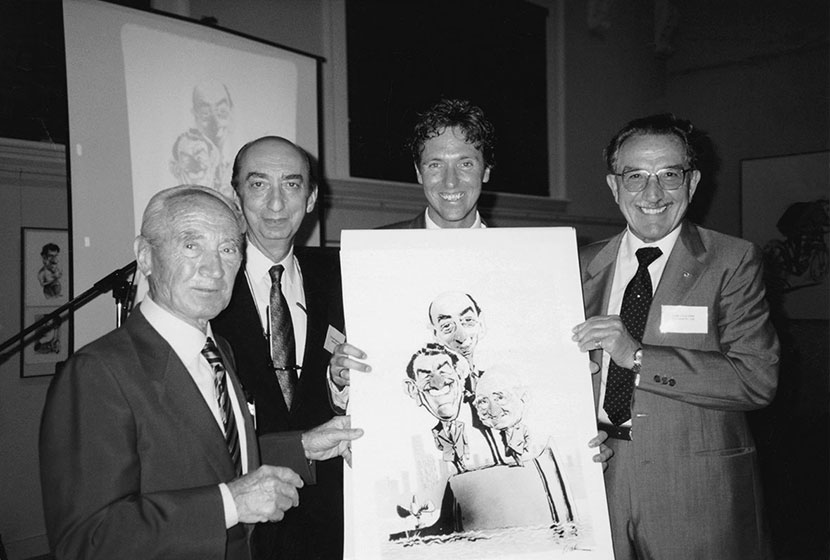 1990. Franco, Vittorio Moratelli and Carlo Salteri with Bill Leak and his rendition of them.
