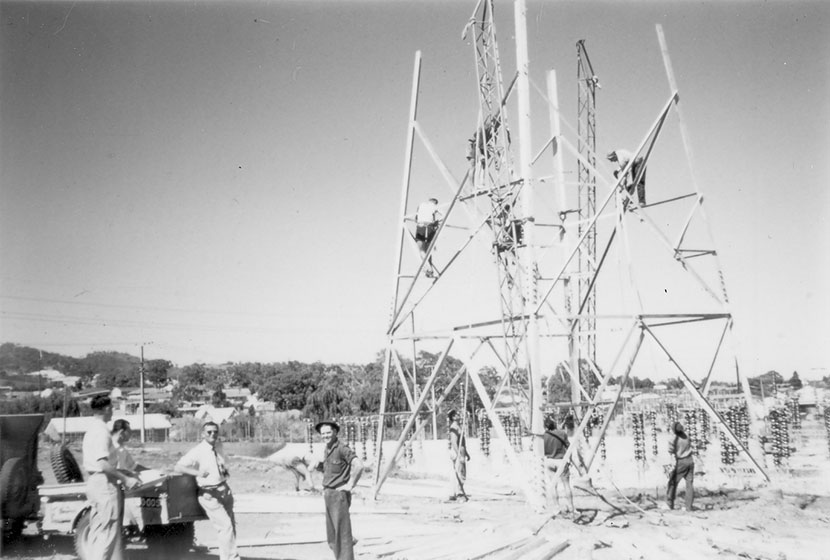 1950s. Transfielders on one of the first transmission lines constructed by the company.