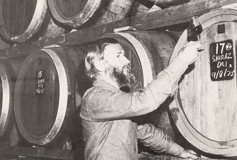 1975. Montrose's first vigneron, Ian MacRae, sampling the first vintage Shiraz in the vinery's cellar.
