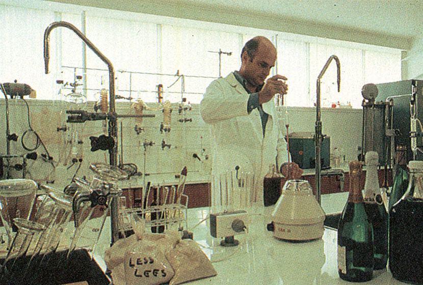 1980. Vigneron Carlo Corino at work in Montrose laboratory at Mudgee, NSW.
