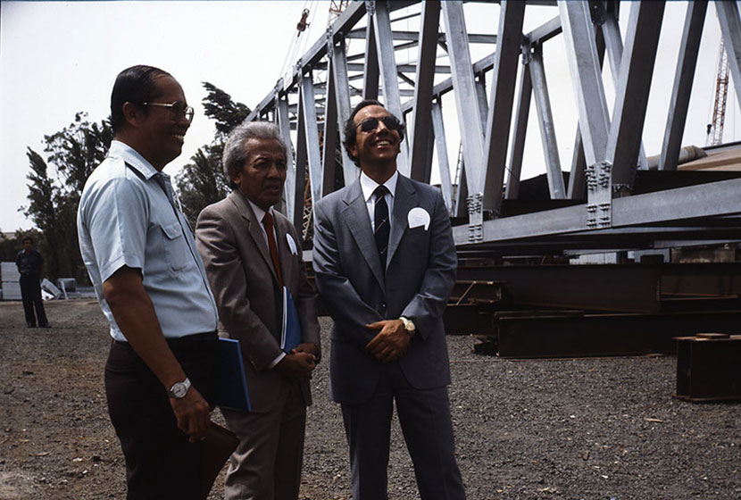 Paul Salteri (first from right) and Indonesian executives inspect a steel bridge.