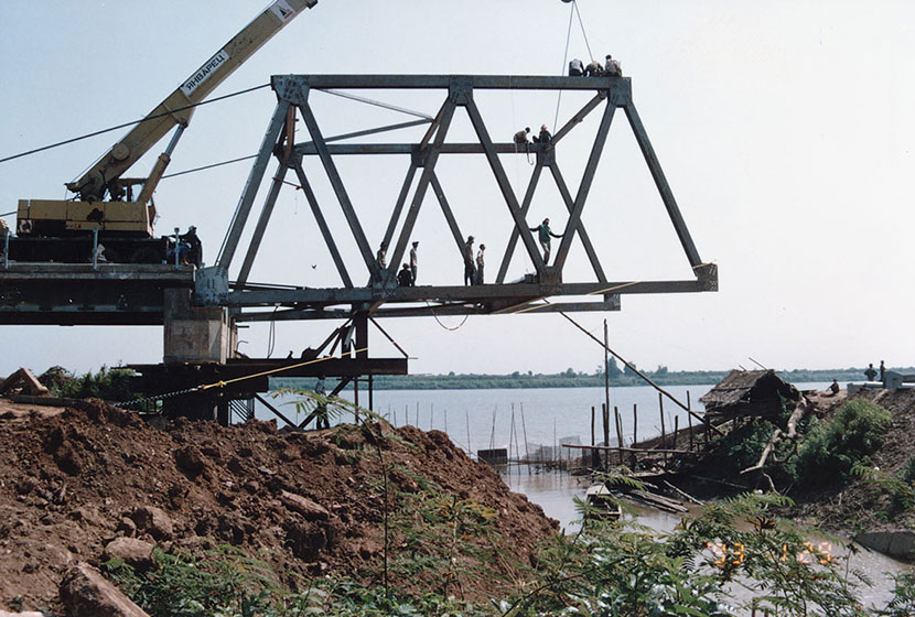 Construction begins on a steel truss bridge in Cambodia.