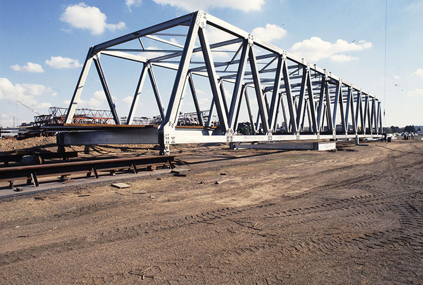 1980s. One of the Indonesian steel truss bridges being trial assembled.