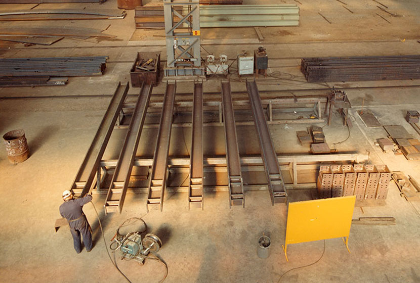 Seven Hills workshop, 1986. Transfield's automatic manufacture of welded beams for Indonesian bridges.