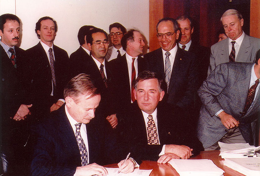 1995. Transfield's Tony Shepherd signing the Concession.